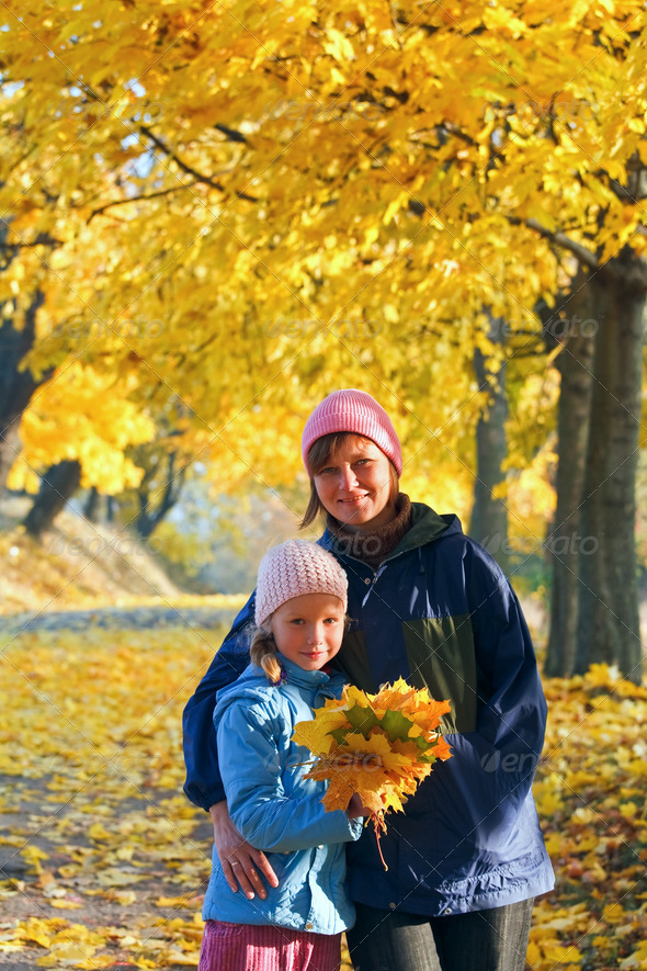 Family in autumn maple park - Stock Photo - Images