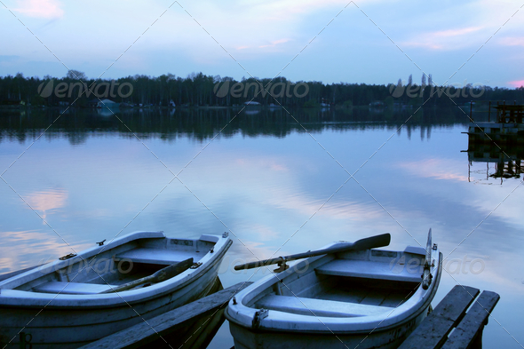 Two small boats at sunset - Stock Photo - Images