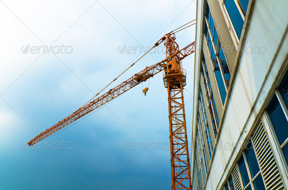 Orange crane lifting - Stock Photo - Images