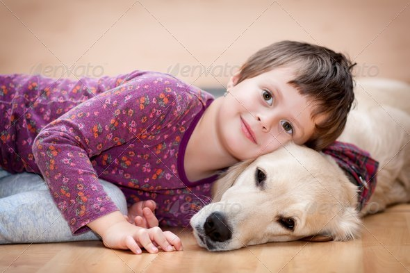 Cute girl and her dog - Stock Photo - Images