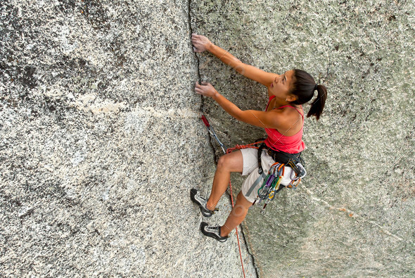 Climber gripping the rock. - Stock Photo - Images