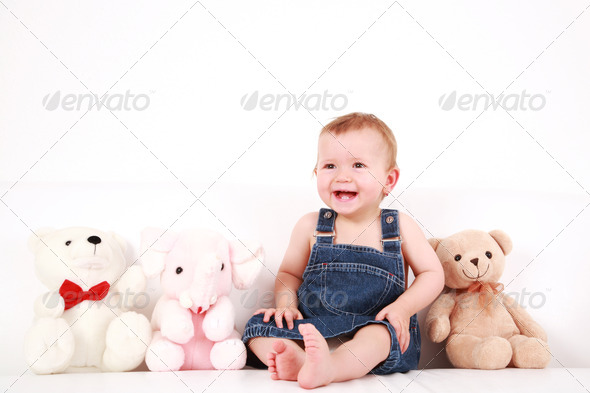 Lovely baby girl with toys - Stock Photo - Images
