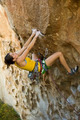 Female climber clinging to a cliff. - PhotoDune Item for Sale