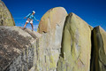 Climber rappelling from the summit. - PhotoDune Item for Sale