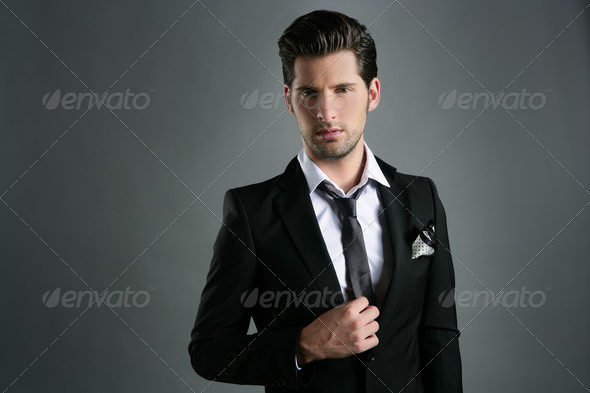 Fashion young businessman black suit casual tie - Stock Photo - Images