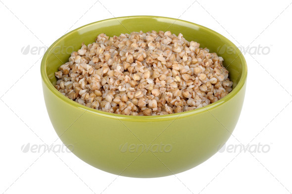 Boiled buckwheat in a green bowl - Stock Photo - Images