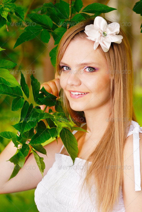 Beautiful face of a young woman - Stock Photo - Images