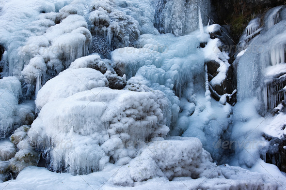 Detail of frozen waterfall in mountains - Stock Photo - Images