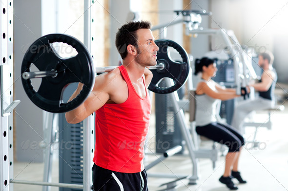 man with dumbbell weight training equipment  gym - Stock Photo - Images