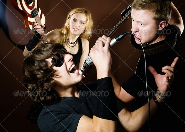Rock band in studio - Stock Photo - Images