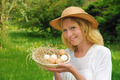 Happy young woman holding fresh eggs - PhotoDune Item for Sale