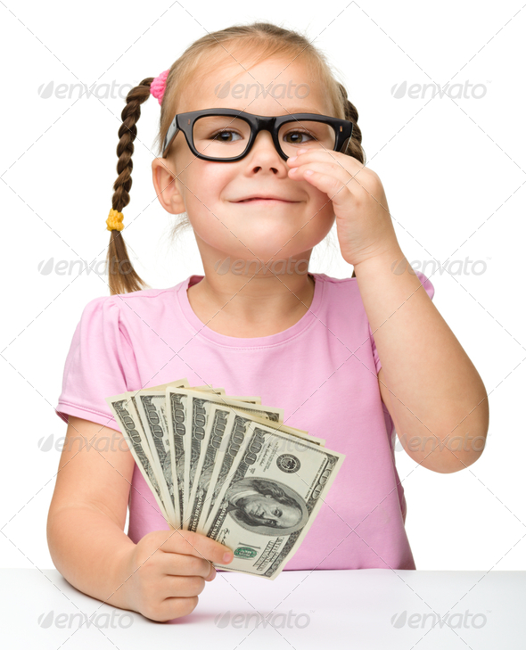 Cute little girl with paper money - dollars - Stock Photo - Images
