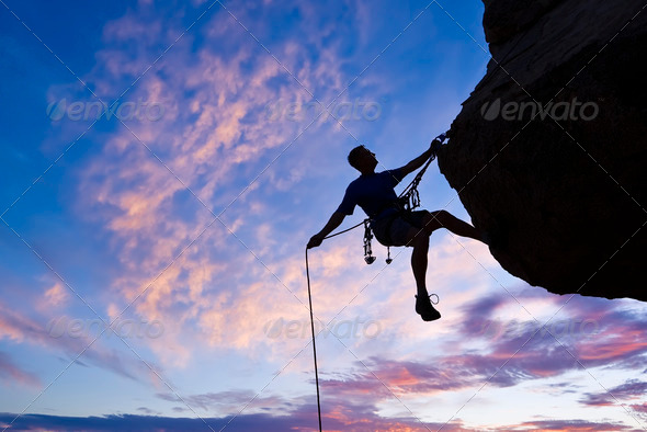 Stock Photo - PhotoDune Rock climber rappelling 1506319