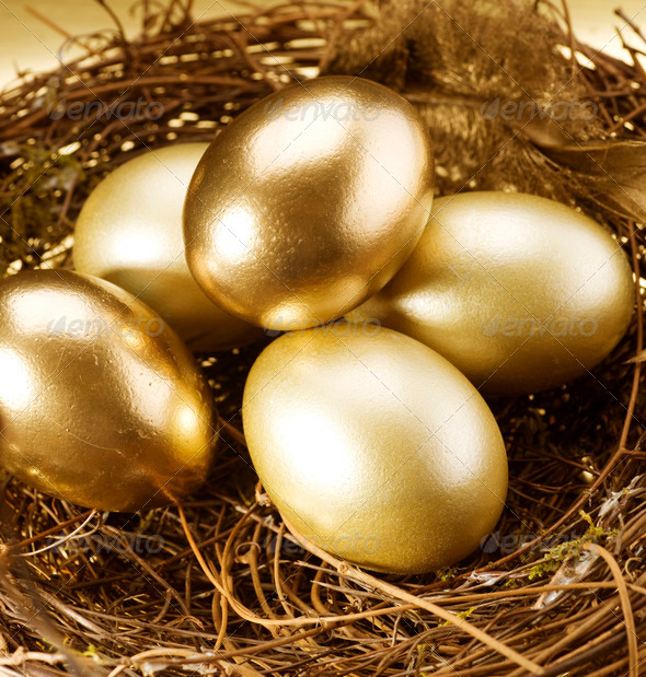 Easter Golden Eggs In A Nest Stock Photo by Subbotina