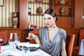 Beautiful Brunette In Restaurant Drinking Wine - PhotoDune Item for Sale