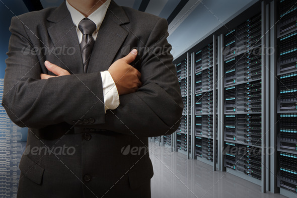 business man engineer in data center server room - Stock Photo - Images