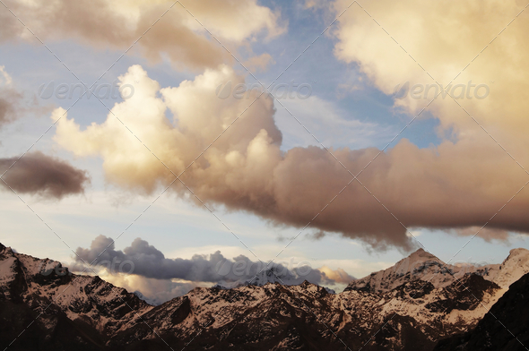 Clouds in the mountains - Stock Photo - Images