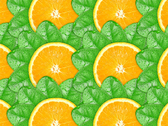 Background of orange slices and green leaf - Stock Photo - Images