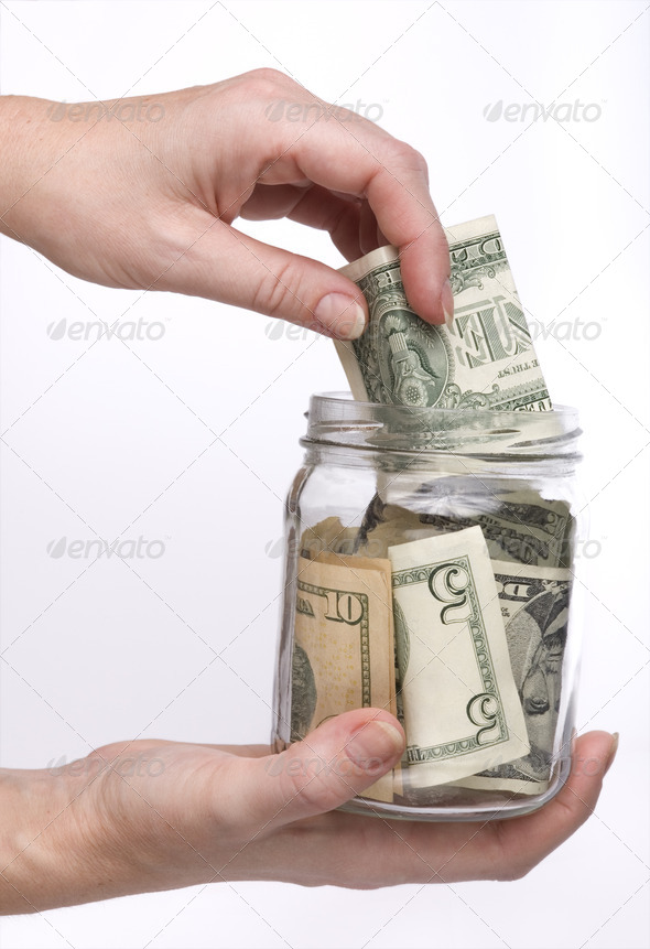 glass jar with money - Stock Photo - Images