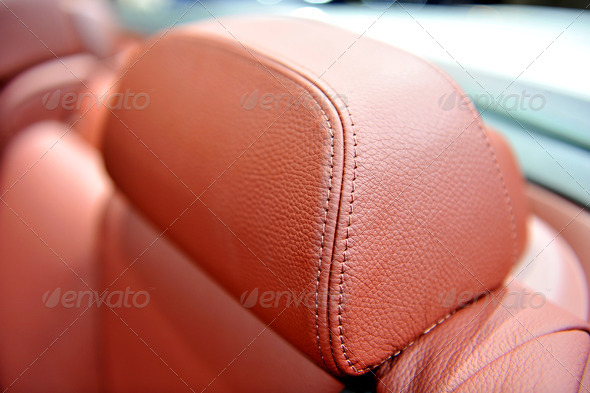 red leather detail of car seat - Stock Photo - Images