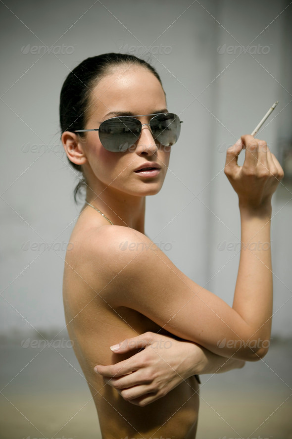 Sexy woman in sunglasses smoking cigarette - Stock Photo - Images