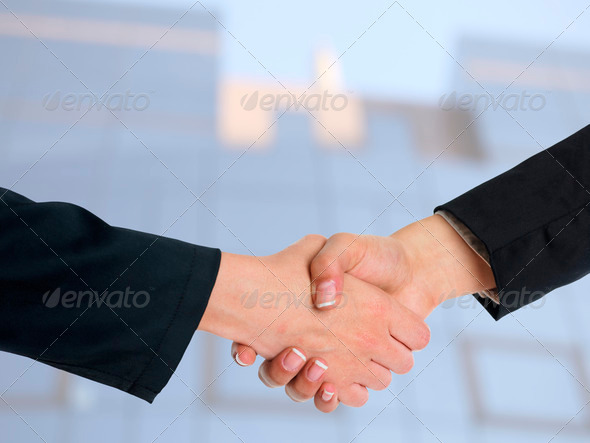 Architectural Handshaking in front of building - Stock Photo - Images