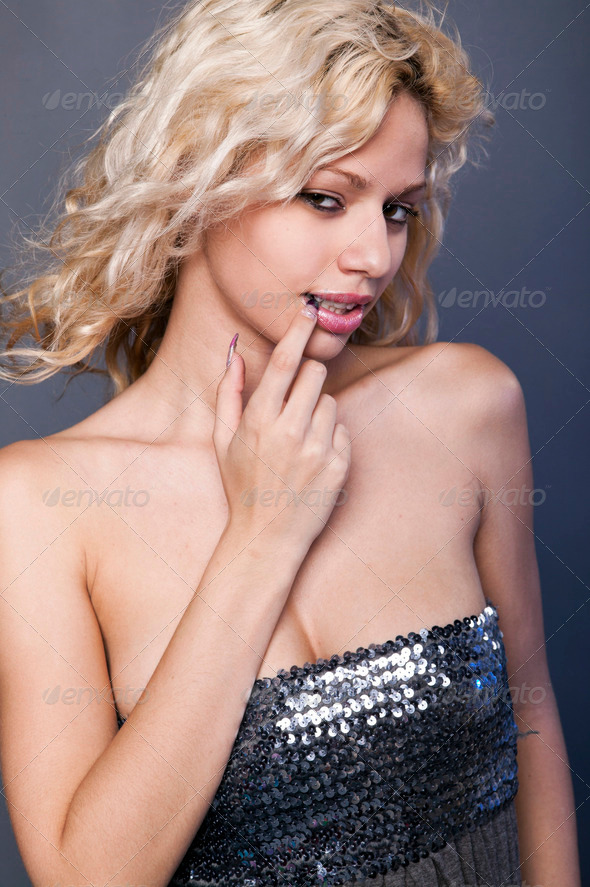 Sexy young blonde woman doing seductive pose in a studio  - Stock Photo - Images