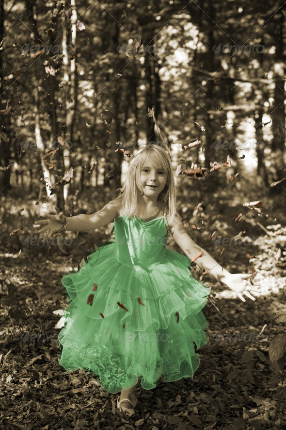 Little girl in fairy costume in the forest - Stock Photo - Images