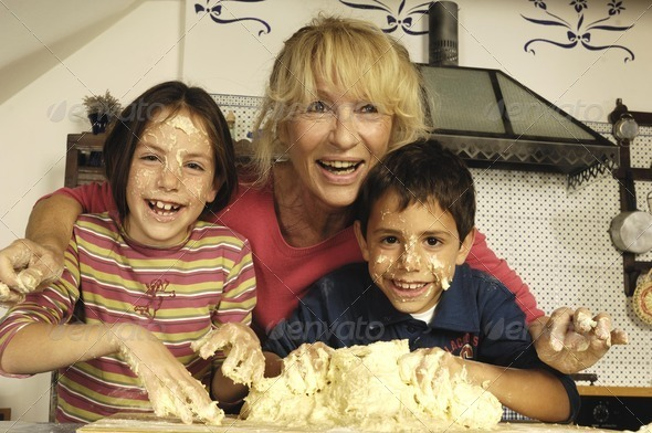 Boy girl and Granmother with bread dough - Stock Photo - Images