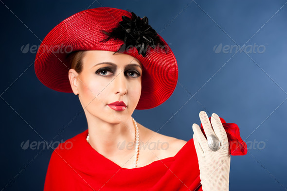 Retro style imitating fashion portrait of a young woman in red hat - Stock Photo - Images