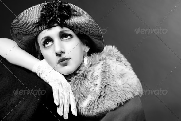 Retro styled fashion portrait of a young woman in hat - Stock Photo - Images