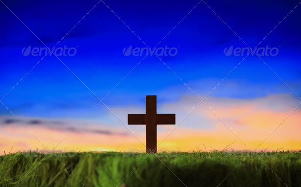 cross silhouette on grass with sunset background - Stock Photo - Images