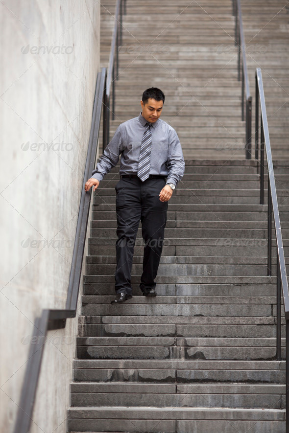 Hispanic Businessman - Walking Down Staircase - Stock Photo - Images