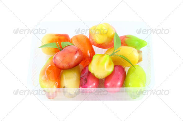 Deletable imitation fruits dessert on plastic package. - Stock Photo - Images