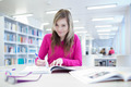 in the library - pretty, female student with laptop and books wo - PhotoDune Item for Sale