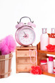 Alarm clock and a lot of pink body care accessories isolated on white - PhotoDune Item for Sale