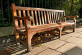 Wooden Park Bench with Memory Plate in the park shade - PhotoDune Item for Sale