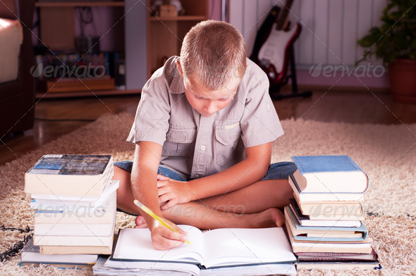 Schoolboy doing his homework - Stock Photo - Images