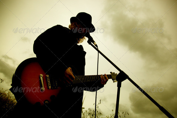 Stock Photo - PhotoDune Man playing guitar outdoors 1671551