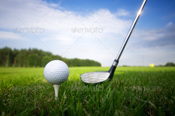 Playing golf. Club and ball on tee - Stock Photo - Images