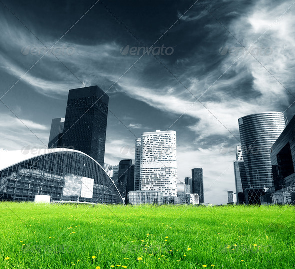 Big city and green fresh meadow - Stock Photo - Images
