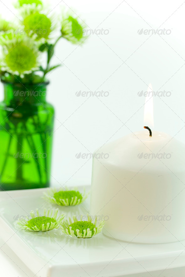 white candle and floating flowers - Stock Photo - Images