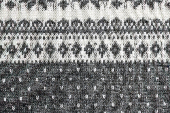 texture of the Norwegian sweater hand-knitted. - Stock Photo - Images