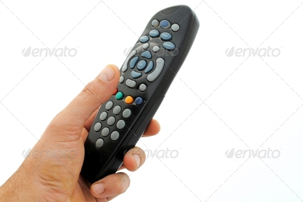 man hand holds a remote controller, isolated on white background - Stock Photo - Images