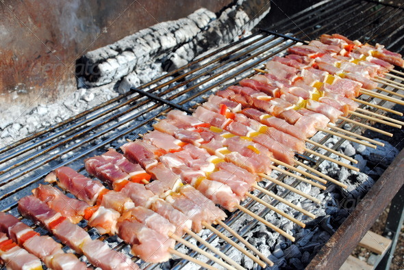 raw pork kabobs grill on skewers on a barbecue - Stock Photo - Images