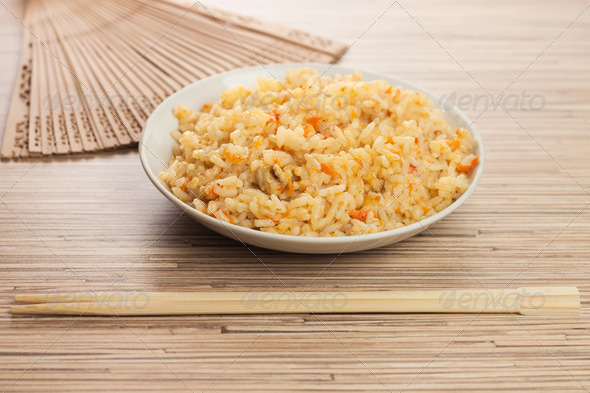 Bowl Of Rice With Chopsticks And Fan - Stock Photo - Images