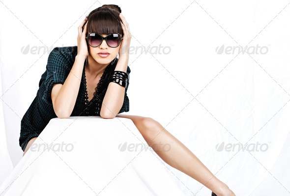 woman with sun glasses on white background - Stock Photo - Images
