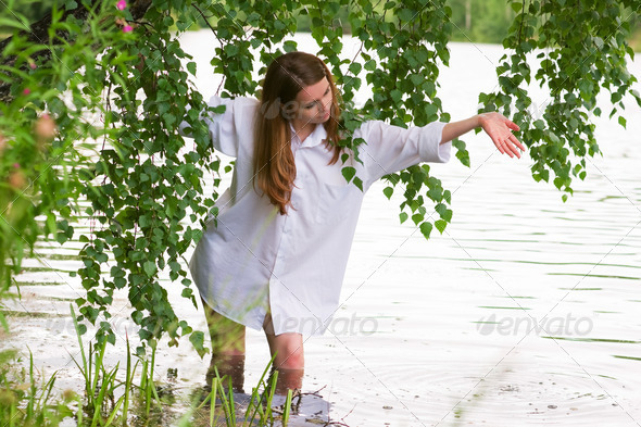 Young Woman By The Lake - Stock Photo - Images