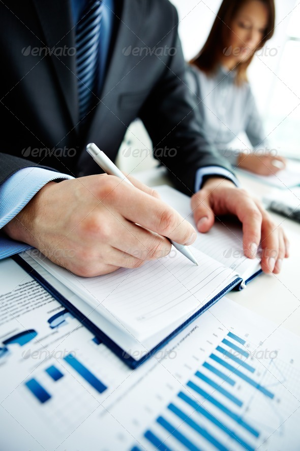 Writing in notepad - Stock Photo - Images
