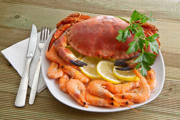Crab with shrimp and parsley on a wooden table - Stock Photo - Images